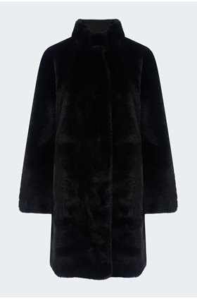 mina reversible faux fur coat in black